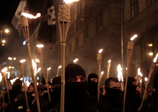 With their faces covered and carrying burning torches, Ukrainian nationalists attempt to march to Kiev's Independence Square to honor the so called Heavenly Hundred