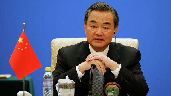 Chinese Foreign Minister Wang Yi speaks during the 13th Russia-India-China Foreign Ministers' Meeting, at Diaoyutai State Guesthouse in Beijing - Sputnik International