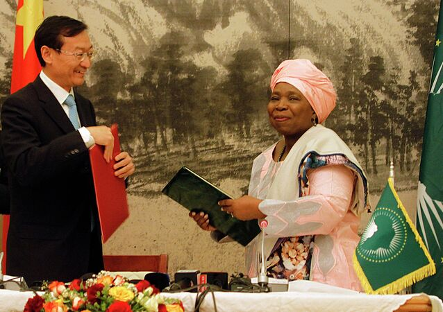 Chairwoman of the African Union Commission Nkosazana Dlamini Zuma (R) together with Chinese Vice Foreign Minister Zhang Ming, exchanging the Memorandum of Understanding