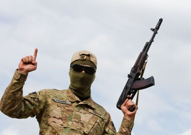 Aidar soldier pose for picture showing the islamic sign of faith