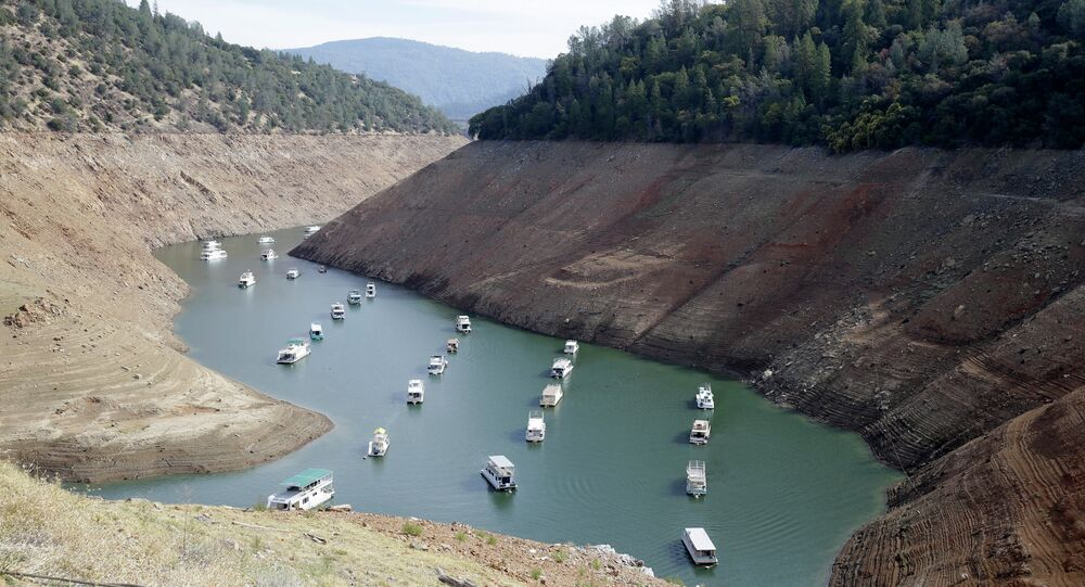 houseboats sit in the drought-lowered waters of Oroville Lake, near Oroville, California.