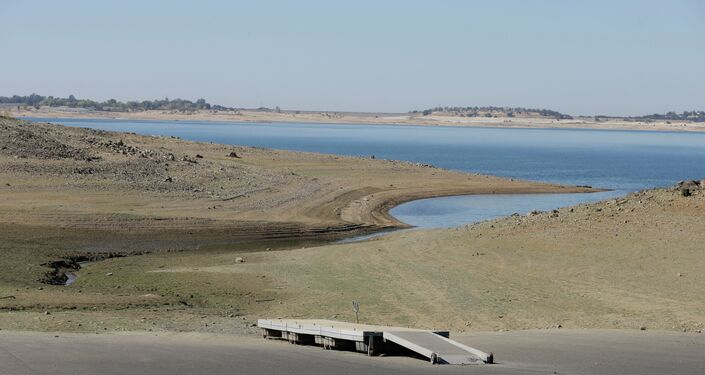 A dock sits high and dry at the end of a boat ramp yards away from the edge of Folsom Lake near Folsom, California.