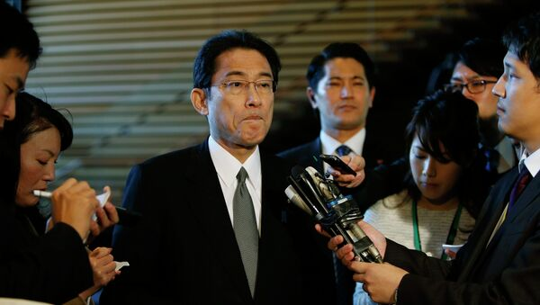 Japan's Foreign Minister Fumio Kishida listens to questions from reporters - Sputnik International