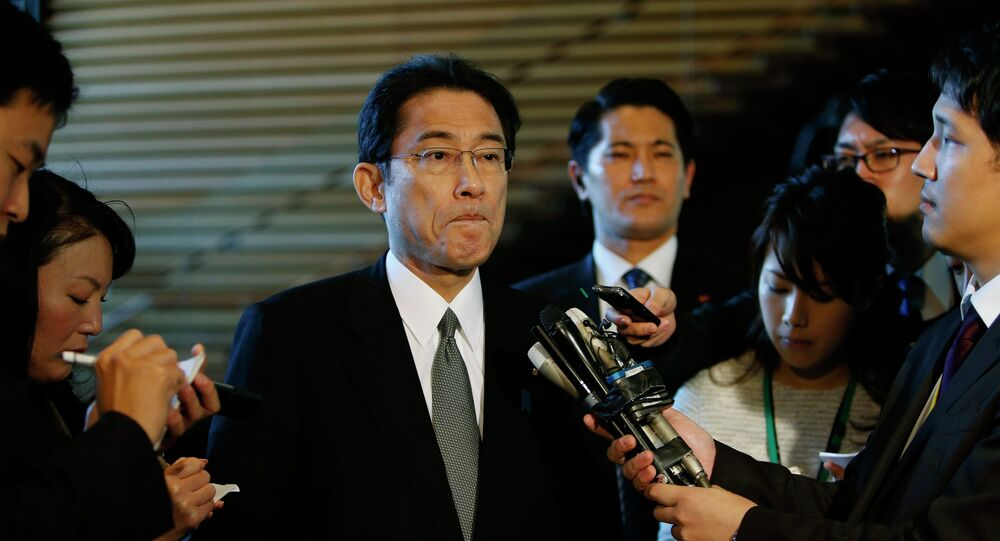 Japan's Foreign Minister Fumio Kishida listens to questions from reporters