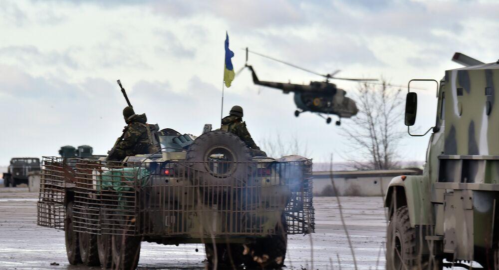 A Ukrainian helicopter flies above the headquarters of the Ukrainian forces in eastern Ukrainian city of Kramatorsk, in the Donetsk region
