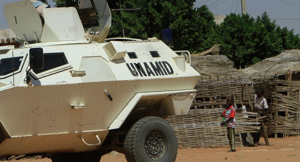 A UN-African Union mission to Darfur (UNAMID) vehicle patrols a street in the city of Nyala in Sudan's Darfur