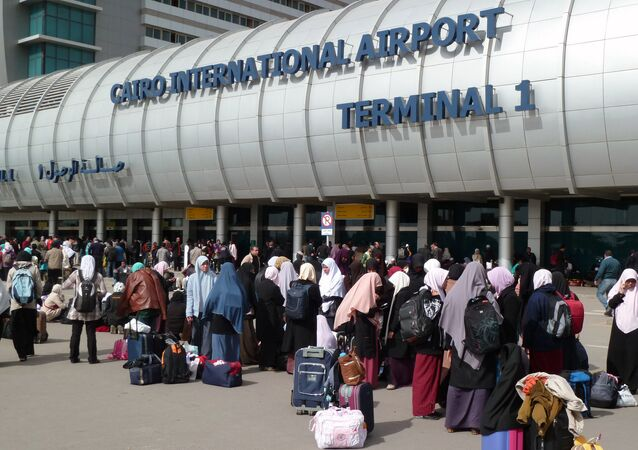 Foreigners crowd the entrance to Cairo's International Airport