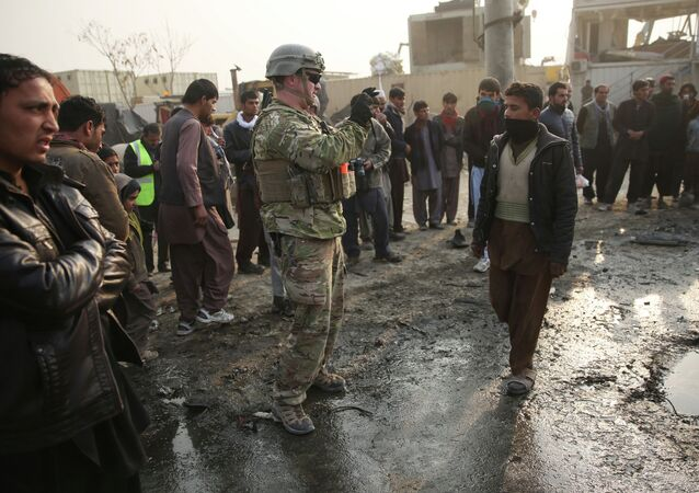 A US soldier at the site of a suicide car bomb attack in Kabul, Afghanistan.