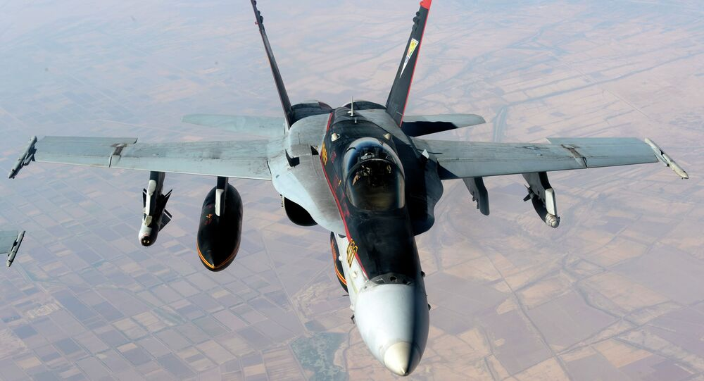 In this Saturday, October 4, 2014 file photo released by the US Air Force, a US Navy F-18E Super Hornet supporting operations against the militant Islamic State group, leaves after receiving fuel from a KC-135 Stratotanker over Iraq