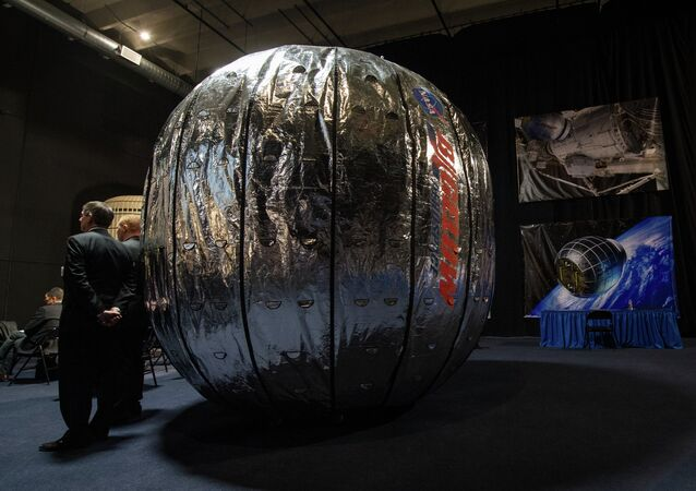 The Bigelow Expandable Activity Module (BEAM) is seen during a media briefing where NASA Deputy Administrator Lori Garver and President and founder of Bigelow Aerospace Robert T. Bigelow announced that BEAM will join the International Space Station to test expandable space habitat technology.