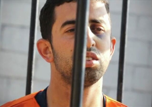 A man purported to be Islamic State captive Jordanian pilot Muath al-Kasaesbeh is seen standing in a cage in this still image from an undated video filmed from an undisclosed location made available on social media on February 3, 2015