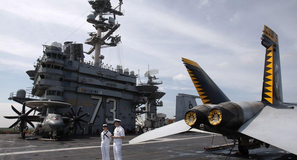 U.S. Navy sailors stand guard on the deck of USS George Washington in Port Klang, outside Kuala Lumpur, Malaysia.