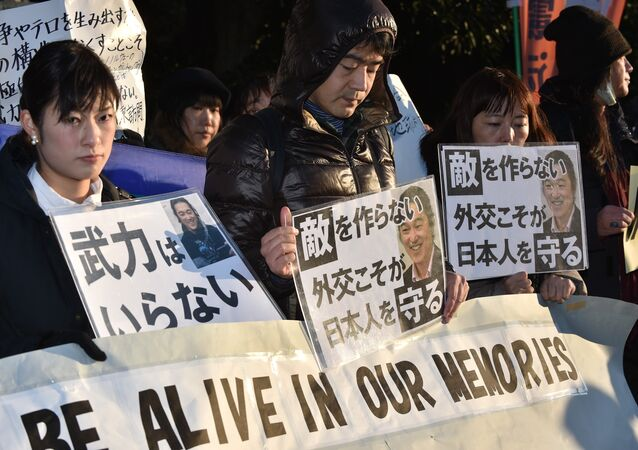 People stage a silent rally for Japanese hostage Kenji Goto called Kenji, You will be alive in our memories