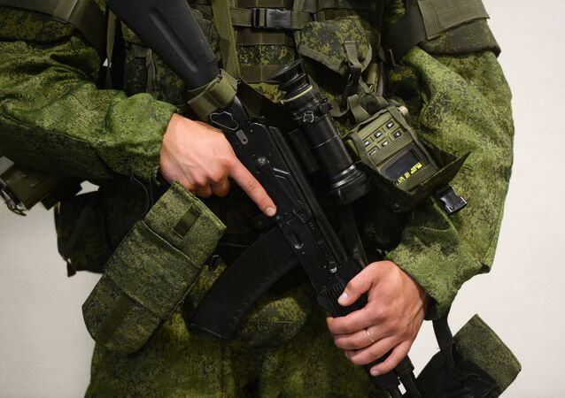 A man demonstrates the new gear of a Russian serviceman designed by Tsniitochmash