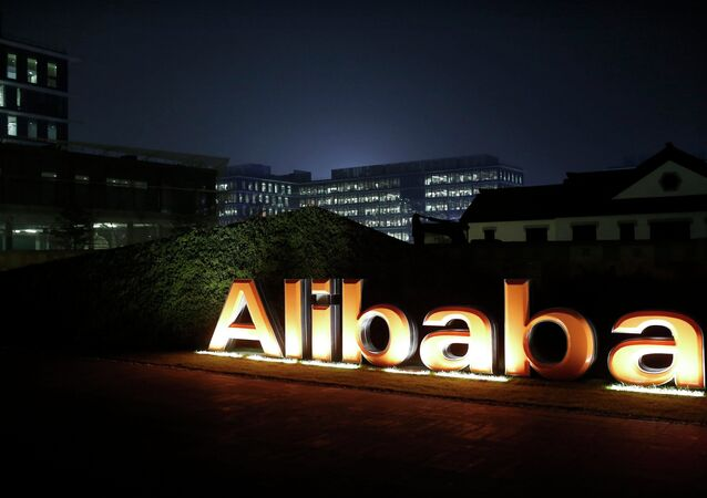 The logo of Alibaba Group is seen inside the company's headquarters in Hangzhou, Zhejiang province early in this November 11, 2014 file photo