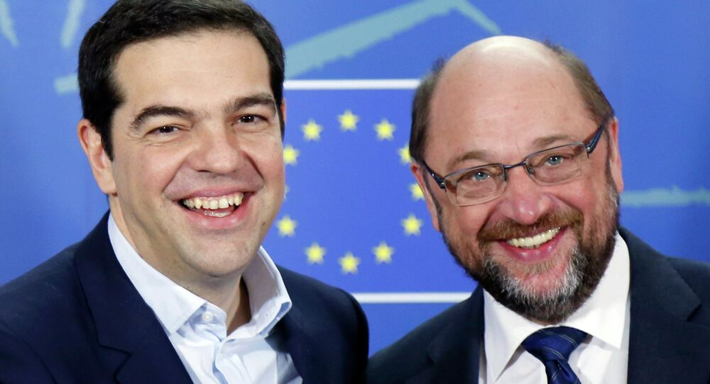 Greek Prime Minister Alexis Tsipras (L) poses with European Parliament President Martin Schulz ahead of a meeting at the EU Parliament in Brussels February 4, 2015