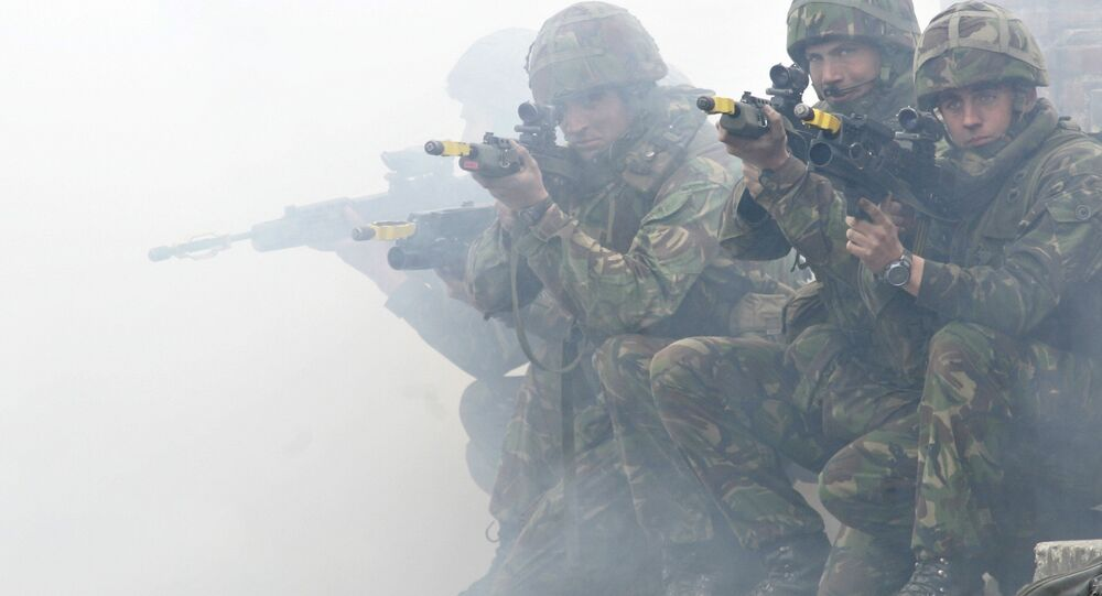 Soldiers from the British Royal Marines Commando demonstrate city fighting techniques during the NATO Response Force exercise
