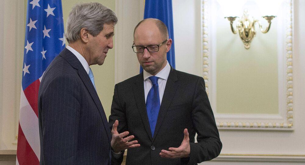 US Secretary of State John Kerry (L) talks with Ukrainian Prime Minister Arseniy Yatsenyuk