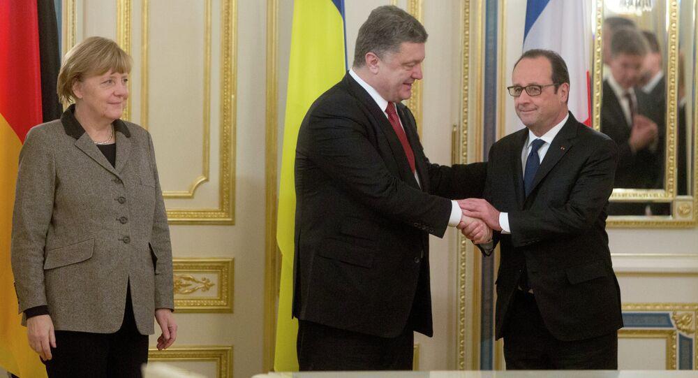 Ukrainian President Petro Poroshenko, center, shakes hands with French President Francois Hollande, right, and German chancellor Angela Merkel during their meeting in Kiev, Ukraine, Thursday, Feb. 5, 2015