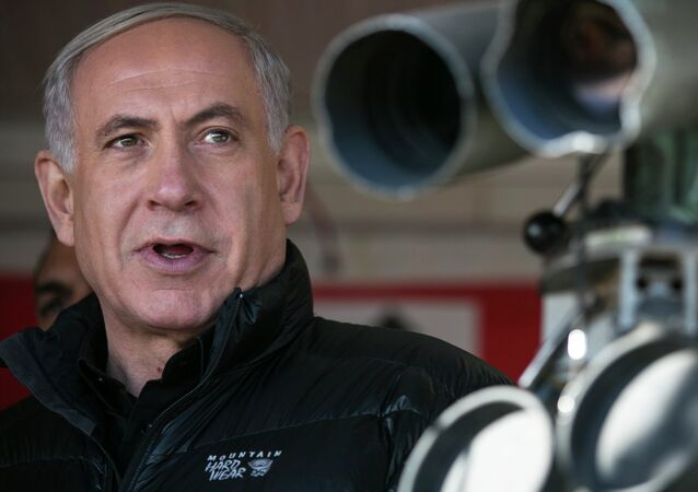 Israel's Prime Minister Benjamin Netanyahu visits at a military outpost during a visit at Mount Hermon in the Israeli-controlled Golan Heights overlooking the Israel-Syria border.
