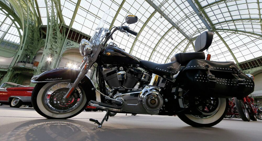 A Harley-Davidson motorcycle blessed with the signature of Emeritus Pope Benedict XVI, and later received by Pope Francis, is displayed ahead of the Bonhams' Les Grandes Marques du Monde vintage motor cars and motorcycles auction at the Grand Palais exhibition hall as part of the Retromobile vintage car show in Paris February 4, 2015