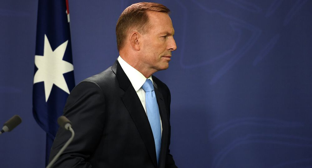 Australia's Prime Minister Tony Abbott leaves following a press conference in Sydney on February 6, 2015.