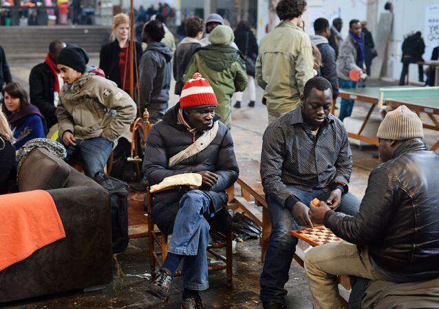 Rejected asylum seekers sit around in the Vluchtkerk (Refugee Church) in Amsterdam.