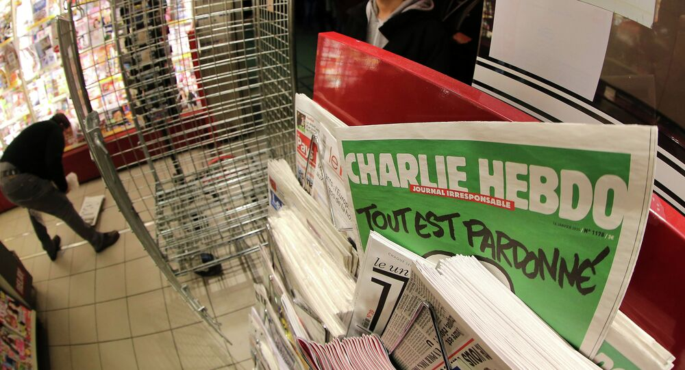 the latest issue of Charlie Hebdo newspaper at a newsstand