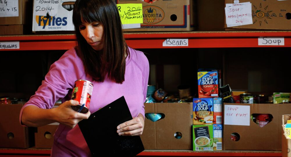 Food bank volunteer Sarah Laughton gathers food for distribution at a food bank in Bromley, south London.