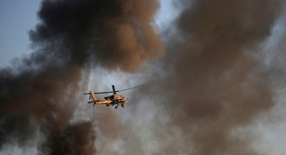 An Israeli Air Force Apache helicopter flies through smoke during a demonstration .
