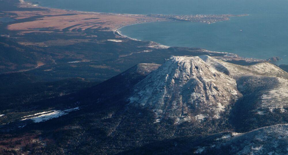 View of Mendeleev volcano and Yuzhno-Kurilsk village on Kunashir island.