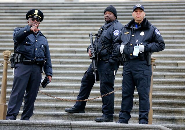U.S. Capitol Hill Police officers stand guard on the East side of the U.S. Capitol before U.S. President Barack Obama makes his sixth State of the Union address inside the House Chambers on Capitol Hill in Washington, January 20, 2015