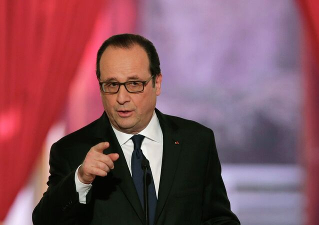 French President Francois Hollande gestures as he answers a question during a news conference at the Elysee Palace in Paris February 5, 2015