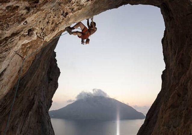 Rock climber on cliff. Kalymnos Island, Greece.