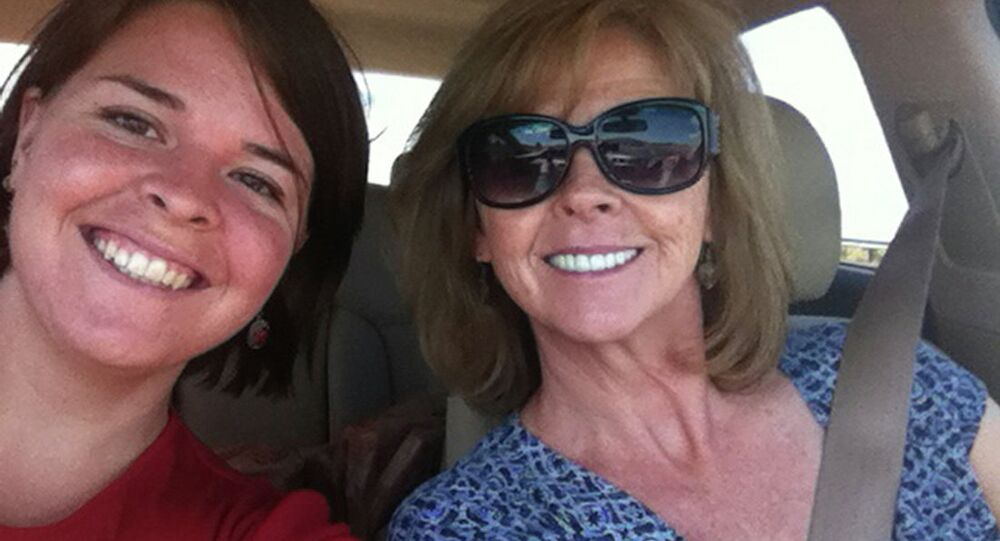 Kayla Mueller (L), 26, an American humanitarian worker from Prescott, Arizona is pictured with her mother Marsha Mueller in this undated handout photo obtained by Reuters February 6, 2015