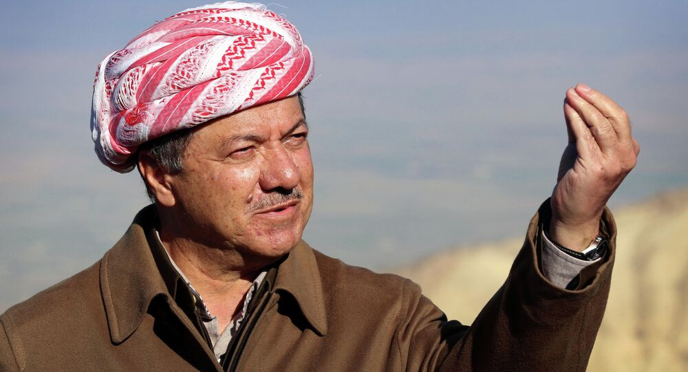 Iraqi Kurdish leader Masoud Barzani speaks to journalists on December 21, 2014 during a visit to Mount Sinjar, west of the northern Iraqi city of Mosul.