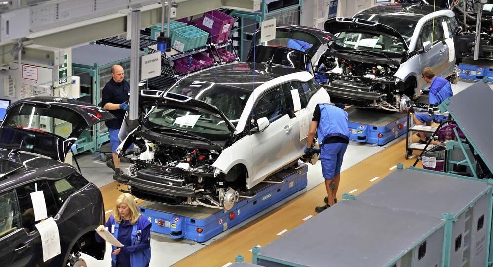 Employees of German carmaker BMW work on the production of the new electrical vehicle i3 at the plant in Leipzig
