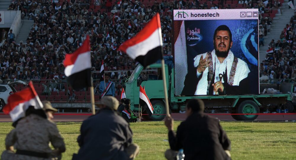 Supporters of Houthi Shiites, who took over the government of Yemen and installed a new committee to govern, listen to a live speech by Abdul-Malik al-Houthi