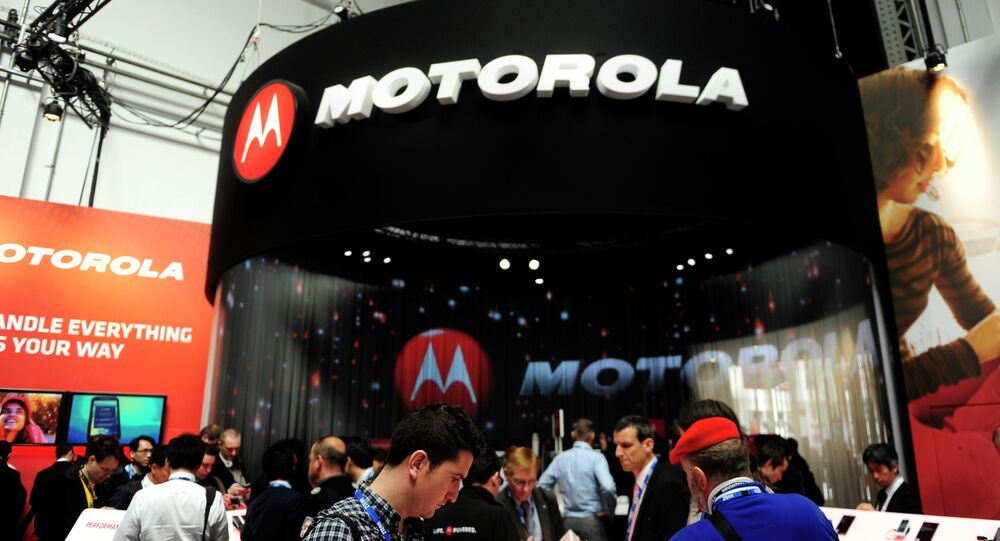 Participants are seen in a Motorola stand at the Mobile World Congress, the world's largest mobile phone trade show, in Barcelona, Spain.