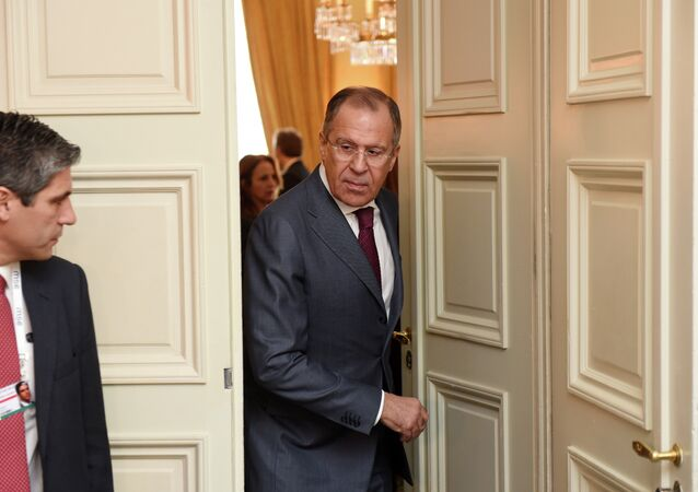 Russian Minister of Foreign Affairs Sergey Lavrov right, leaves a room after talks during the 51st Security Conference  in Munich, Germany, Sunday Feb. 8, 2015