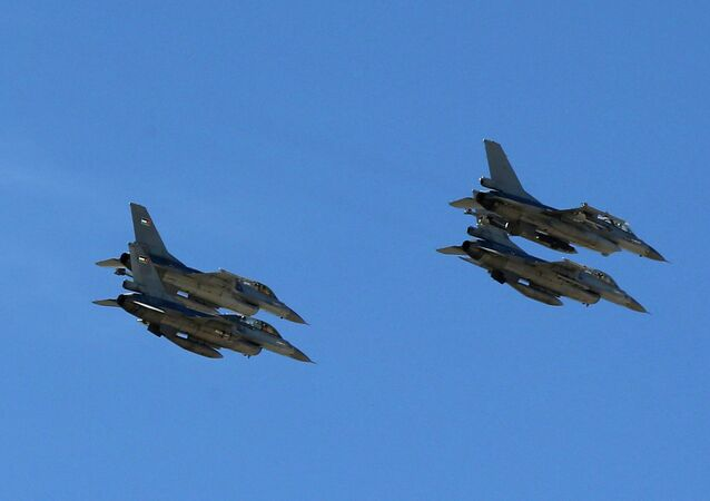 Planes belonging to the Jordanian Royal Air Force fly over the headquarters of the family clan of pilot Muath al-Kasaesbeh in the city of Karak February 4, 2015