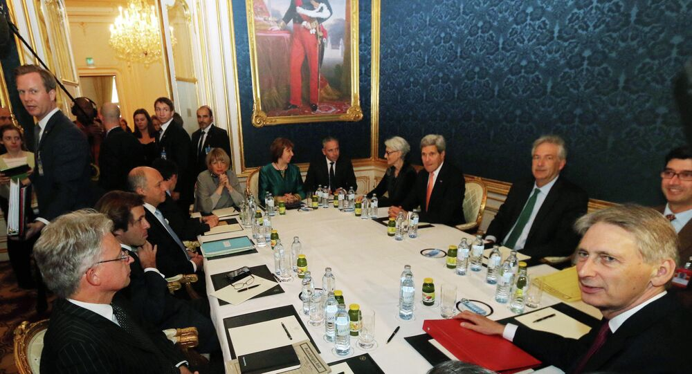 French Foreign Minister Laurent Fabius, sitting third left, former EU foreign policy chief Catherine Ashton, rear center, U.S. Secretary of State John Kerry, fourth right, and British Foreign Secretary Philip Hammond wait for the start of closed-door nuclear talks on Iran in Vienna, Austria, Friday, Nov. 21, 2014
