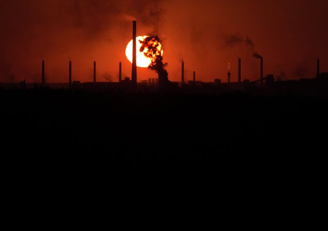 The sun sets over a chemical factory near the city of Donetsk