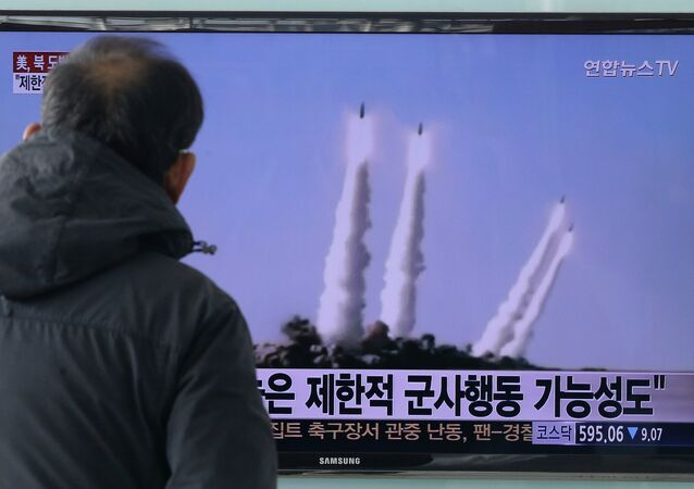 A man watches a TV news program showing the file footage of the missile launch conducted by North Korea, at Seoul Railway Station in Seoul, South Korea, Monday, February 9, 2015.