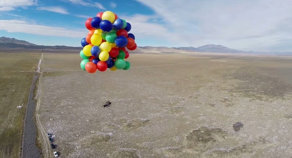 GoPro Athlete Erik Roner floats 8,000 feet into the sky in a lawn chair attached to 90 weather balloons