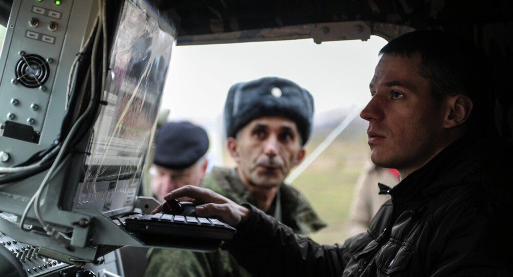 An operator of an electronic warfare unit