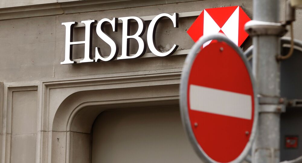 A traffic sign is seen in front of a branch office of HSBC bank at the Paradeplatz in Zurich February 9, 2015