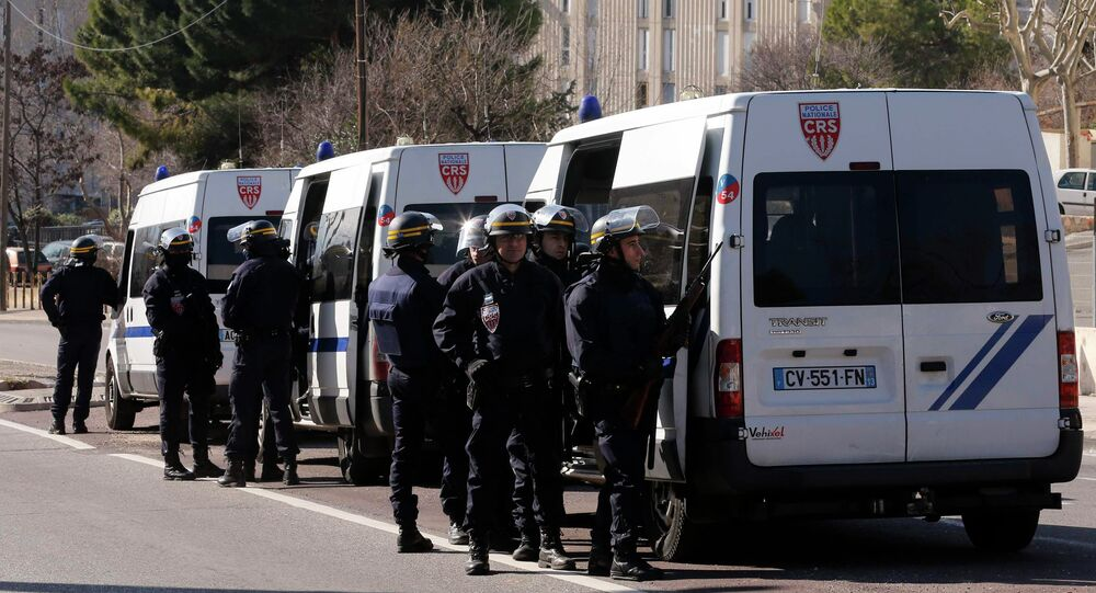 French CRS riot police officers secure the access to the Castellane housing area in Marseille, February 9, 2015