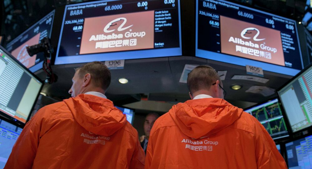 Specialist traders work at the post that trades Alibaba Group Holding Ltd during the company's initial public offering under the ticker BABA at the New York Stock Exchange.