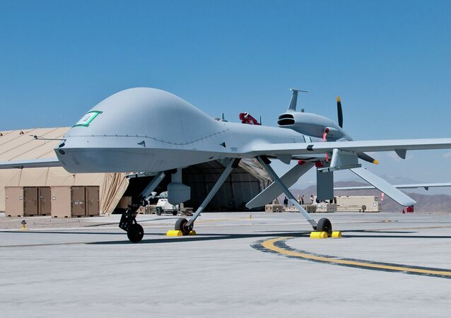 Two freshly assembled Grey Eagle unmanned aerial vehicles sit on the tarmac at Forward Operating Base Shan in Logar Province, Afghanistan April 11, 2012